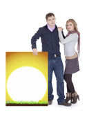 Couple with a sunshine banner — Stock Photo