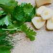 Foto Stock: Garlic and greenery