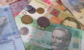 Paper and metallic currency — Stockfoto