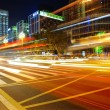 High speed and blurred bus light trails in downtown nightscape — Stock Photo #10086189