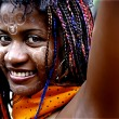 Madagascan girl with colourful braids - Stock Photo