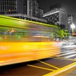 High speed and blurred bus light trails in downtown nightscape — Stock Photo #7992967
