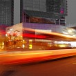 High speed and blurred bus light trails in downtown nightscape — Stock Photo #7993817