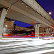 High speed traffic and blurred light trails under the overpass — Stock Photo #7993828