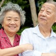 An intimate senior couple embraced — Stock Photo