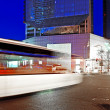 High speed and blurred bus light trails in downtown nightscape — Stock Photo #7994020