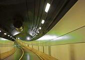 Curved road in tunnel — Stock Photo