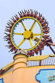 Rotating wheel in the amusement park — Stock Photo