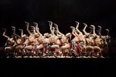 Chinese dancers perform modern group dance on stage — Stock Photo