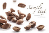Jumping coffee beans — Stock Photo