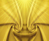 Golden satin and rays — Stock Photo