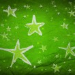 Stars on green paper — Stock Photo
