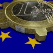 Depression - EURO coin as broken cogwheel - Stock Photo