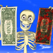 Money laundering - cartoon of skeleton with dollar bills - Stock Photo