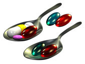 Pills on spoon, white background — Stock Photo