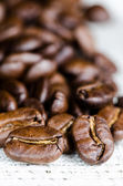 Coffee beans in a linen napkin — Stock Photo