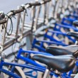 Bicycles in rain - Stock Photo