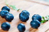 Large blueberries on a wooden board — Stock Photo