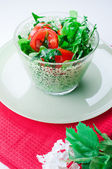 Vegetable salad in a green glass bowl close up — Stock Photo