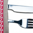 Knife and fork on gray napkin - Stock Photo