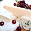 Red wine and brie parmesan and blue cheese — Stock Photo
