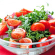 Tomato salad with ruccola and onion — Stock Photo