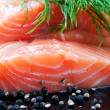 Salmon with black pepper and dill on plate - Stock Photo