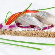 Herring sandwich on rye bread — Stock Photo #9108593