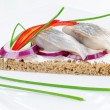 Herring sandwich on rye bread — Stock Photo