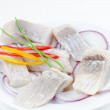 Marinated herring bites on a plate — Stock Photo