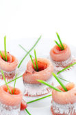 Herring rolls with spring onion — Stock Photo