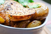 Baked potato in bowl — Stock Photo