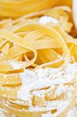 Italian pasta and flour — Stock Photo