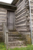 The stairs and door of old house — Stock Photo