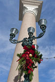 Christmas decoration on street light — Stock Photo
