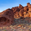 The unique red sandstone rock formations on sunset - Stock Photo