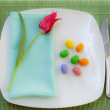 Easter place setting with spring flowers and blossom — Stock Photo #9634151