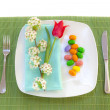 Easter place setting with spring flowers and blossom — Stock Photo