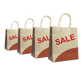Shopping bags with the word sale isolated on white — Stock Photo