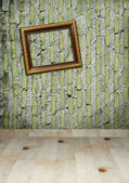 Gold frame on a old wall room background — Стоковое фото