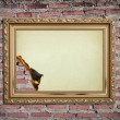 Vintage gold frame with burned on wall background — Stock Photo #10080293