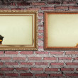 Vintage gold frame with burned on wall background — Stock Photo #10080335