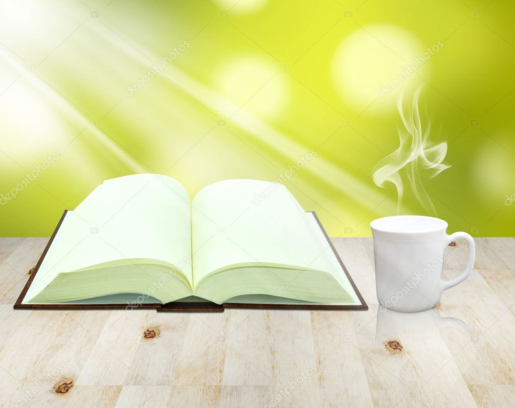 Open book and cup of coffee — Stock Photo #10095280