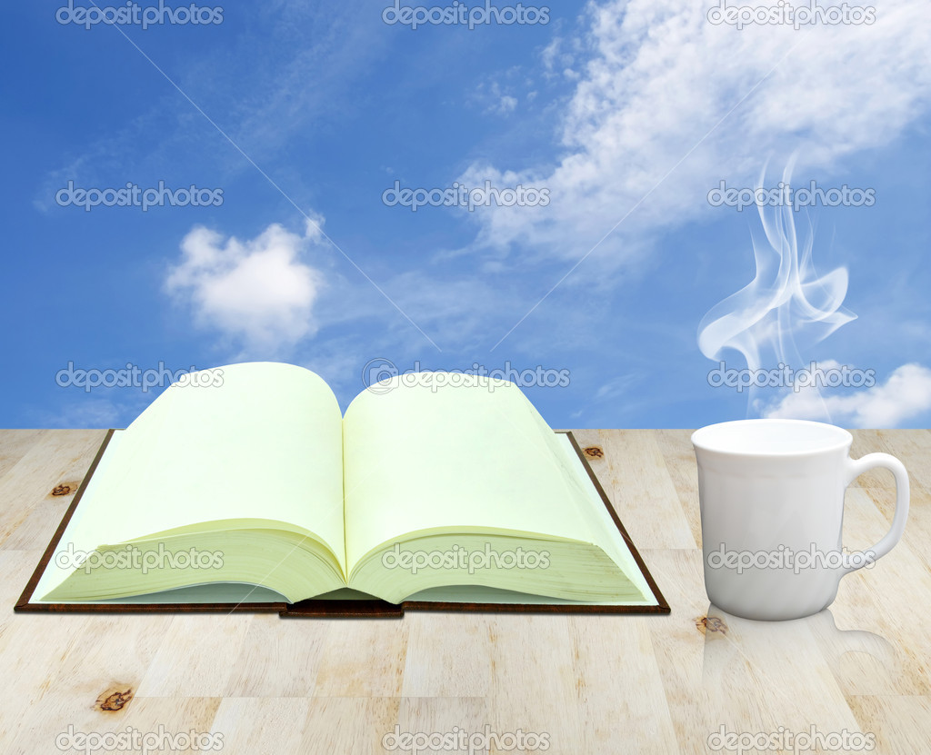 Open book and cup of coffee — Stock Photo #10095367
