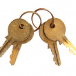 Bunch of old keys isolated on white — Stock Photo
