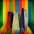 Shopping bags on colorful wood Background — Stock Photo