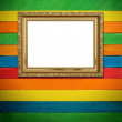 Stock Photo: Gold frame on colorful wood Background