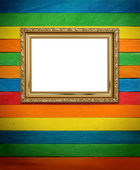 Gold frame on colorful wood Background — Stock Photo