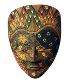 Painted indonesian mask with flowers — Stock Photo