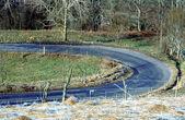 Otáčení silniční a matné pole — Stock fotografie